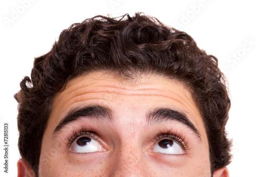 Leinwanddruck Bild Young man looking up