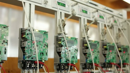 Digital electricity meters on a test stand