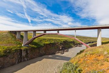 Modern bridge over Icelandic river