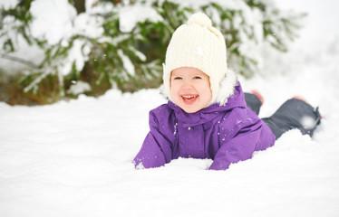 Happy child baby girl in snow  winter