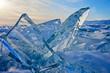 Baikal. Transparent blue ice floes at sunset