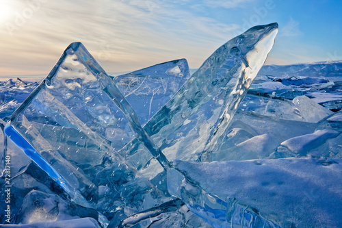 Baikal. Transparent blue ice floes at sunset