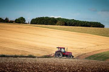 Tractor harrowing a field west of Poitiers in south western Fran