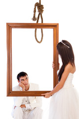 Bride and groom with a hanging rope