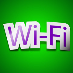 Free wifi icon sign. Symbol chic colored sticky label on green