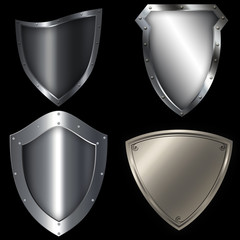 Medieval silver shields set.