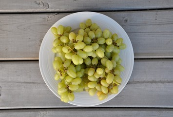 Green grapes in white plate