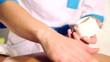 Closeup hands of the masseur.