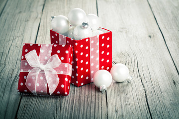 red Christmas gift box, polka dots, on wood background