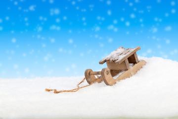 Old vintage wooden sled on blue background