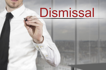 businessman writing dismissal in the air