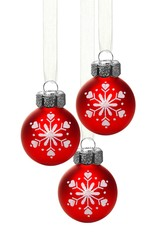 Hanging red Christmas ornaments with snowflakes