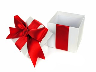 Opened white Christmas gift box with lid red bow and ribbon