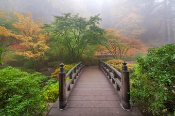 Moon Bridge in Japanese Garden Foggy Colorful Fall Morning