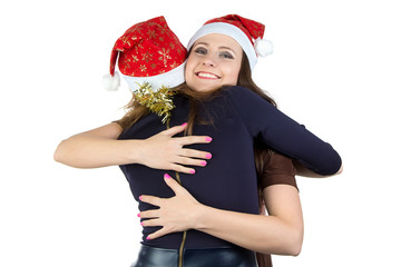 Image of two happy hugging young women
