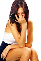 Sad woman with smart phone