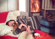 girl with a cat in front of a stove - Cosiness 01