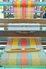 Ancient style woven silk machine in Thailand