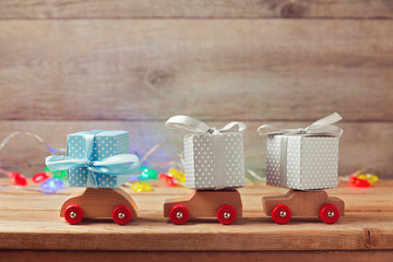 Christmas holiday concept with gift boxes on toy cars
