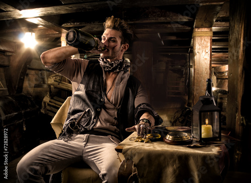 Pirate Drinking from Bottle in Ship Quarters - 72828972