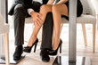 Legs of a couple sitting at the restaurant - 72829147