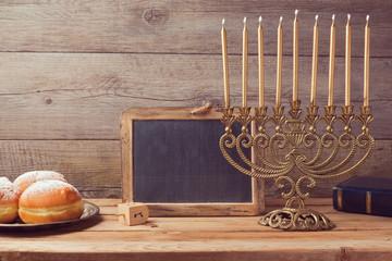 Jewish hanukkah celebration with vintage menorah and chalkboard