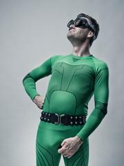 Funny lazy superhero looking up