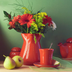 Vintage still life with red tableware, flowers and fruits