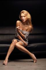 Sensual woman on the sofa