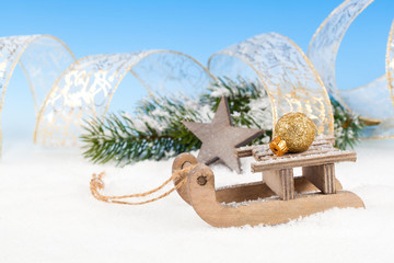 Christmas decoration over snow, blue background