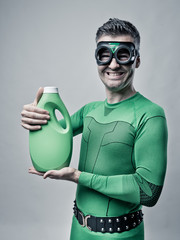Superhero showing an eco-detergent for laundry