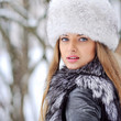 canvas print picture - Beautiful woman in furry hat in winter - close up