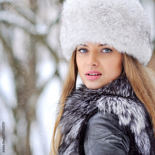 canvas print picture Beautiful woman in furry hat in winter - close up