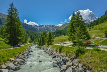 Flowing stream near Matterhorn, the top of Swiss Alps
