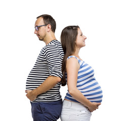 Pregnant couple posing in studio