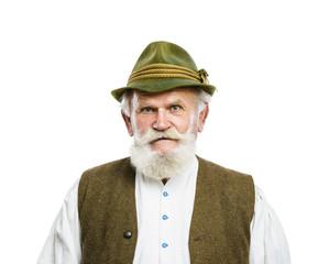 Old bavarian man in hat on white background
