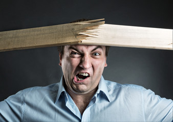 Man break wooden strip