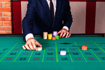 Man by roulette table in casino