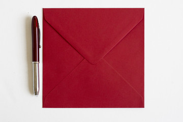 red Envelope and pen on isolated background