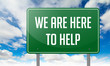 We Are Here to Help on Highway Signpost.