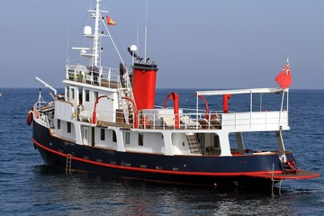 Classic tug converted in luxury yacht