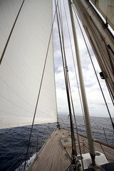 Details of the deck of a sailing boat in open waters.