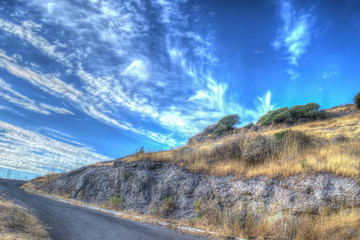 Winding road under a cloudy sky