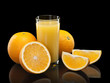 canvas print picture - Glass of orange juice with fruit