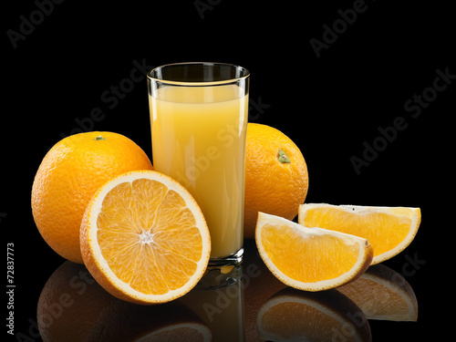 canvas print picture Glass of orange juice with fruit