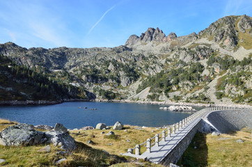 Artificial lake with a dam in the Haut-Pyrenees