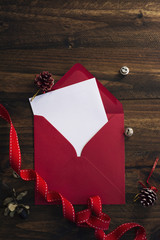 red envelope, white note and Christmas decoration