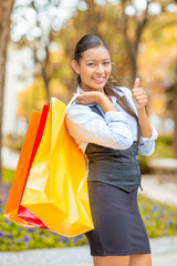shopping happy fashion young woman showing thumbs up