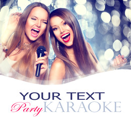 Karaoke. Beauty girls with a microphone singing and dancing