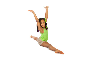 girl is engaged in gymnastics. child sitting on the splits.